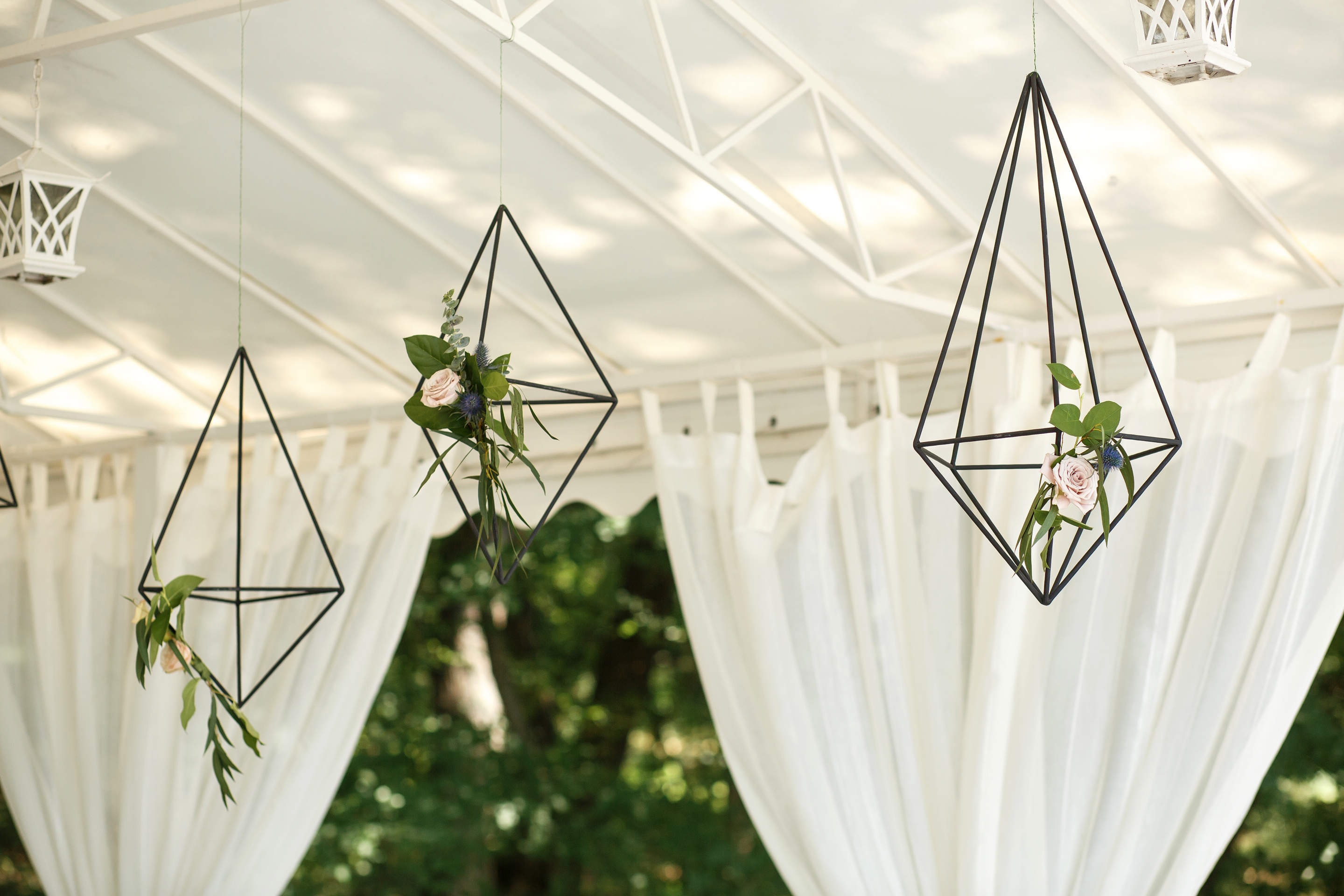 Decorative Hanging Cages With Fresh Flowers. Event Flowers Decoration. Wedding Decor.